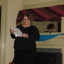 Darlene giving a reading